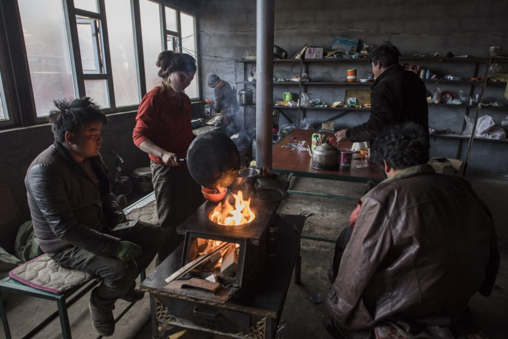 """Workers take lunch in the factory. They like Tibetan traditional staple food """"Tsampa"""". They like cup noodles of Chinese taste too."""