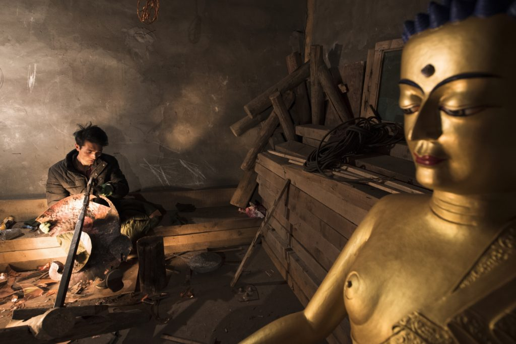 Buddhist statues are painted or put gold leafs, then moved to Tibetan monasteries. The price of Buddhist statues is about 8,000 to 9,000 USD.